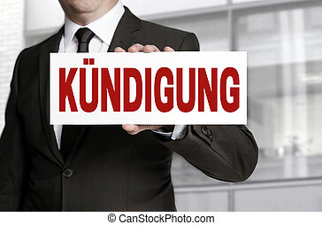 termination sign held by businessman