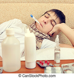 Sick Teenager with Thermometer - Toned Photo of Sick...