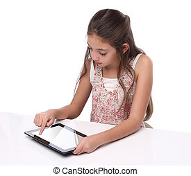 Beautiful pre-teen girl using a tablet computer. Isolated on...