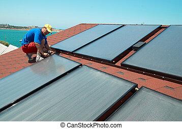 Worker installs solar panels