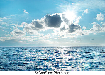 Seascape with clouds - Sea with blue water, sky and clouds....