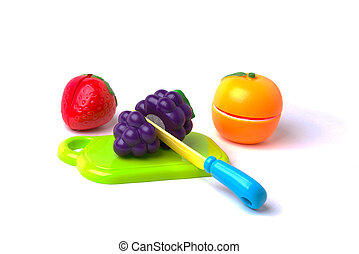 Plastic Fruits Cut in Half - A plastic toy strawberry,...