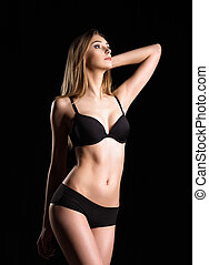 Studio fashion shot of sexy young woman in underwear -...