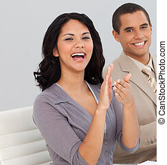 Business people at a presentation Clapping - Young Business...