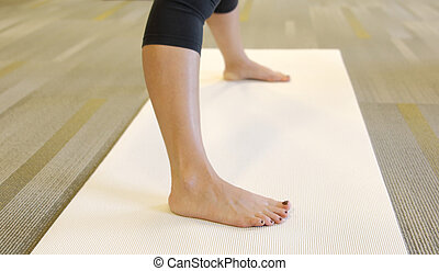 Caucasian adult female in yoga class.