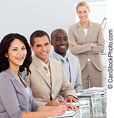 Business team in a meeting smiling