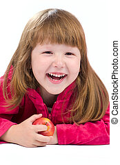 Laughing child - Cheerful kid holding apple and laughing...