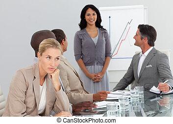 woman bored at a presentation - Young woman bored at a...