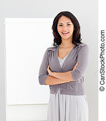Woman standing at a presentation Board