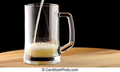 Light Beer is Poured into a Mug