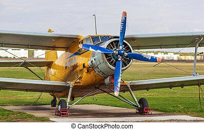 Vintage biplane - Old yellow vintage single-engined biplane...