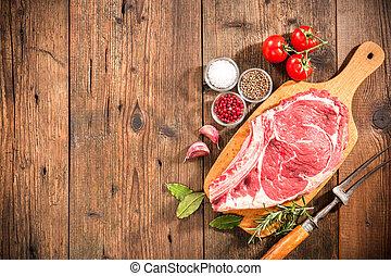 Rib eye steak - Raw fresh meat rib eye steak and seasoning...