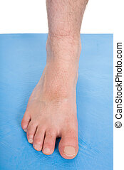 body parts - male foot on blue mat