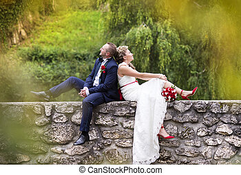 Young wedding couple enjoying romantic moments in front of a...