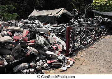 Junk yard - Salvage yard in Thailand. Various car parts and...