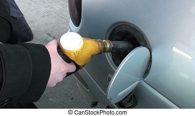 gas pump nozzle in action