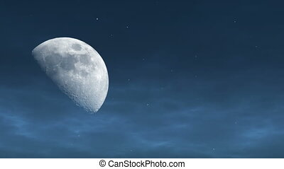 Moon in the evening - Rising half moon and light clouds on...