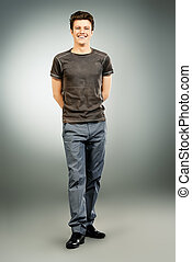 full length - Full length portrait of a cheerful young man....