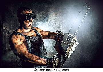 machinery - Shouting muscular man with a chainsaw over dark...