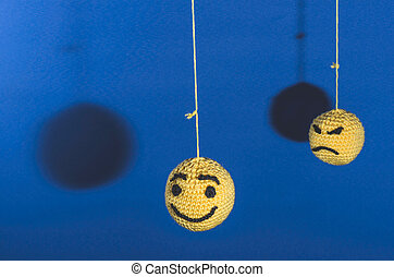 Knitted emoticons - Knitted yellow emoticons on blue...