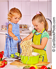 Children cooking at kitchen.