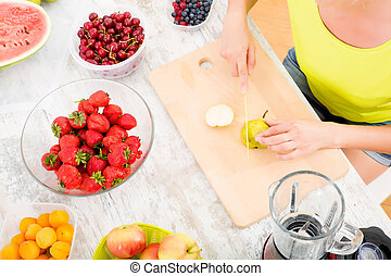 Mature woman preparing a smoothie - A beautiful mature woman...
