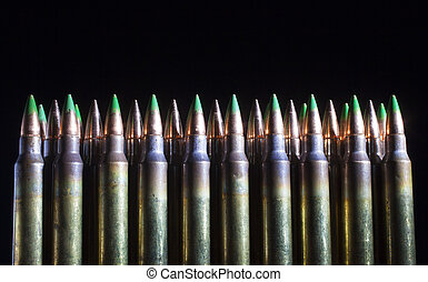 Green lineup - Cartridges with green tipped bullets on front...
