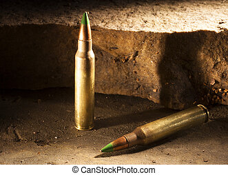 Armor piercing duo - Pair of green tipped rifle cartridges...