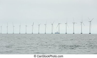 Wind tubines - Offshore wind turbines at the sea in...