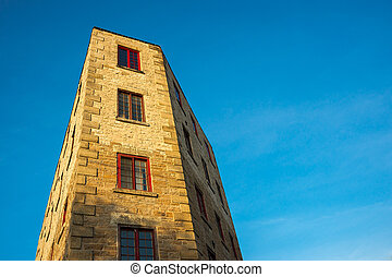 Oddly Shaped Building Against Blue Sky - An oddly shaped...