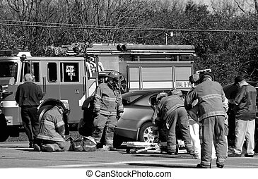 Car Accident - Fire fighters at work on the scene of...