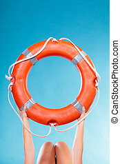 Life buoy ring in female hands - Accident prevention and...