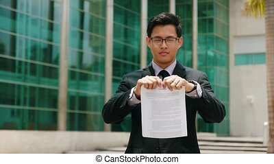 Portrait Chinese Businessman Tearing Contract And Throwing...