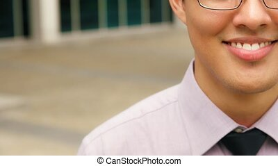 Portrait Cropped Face Of Young Chinese Businessman Outside Office