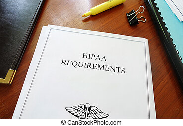 HIPAA Requirements healthcare privacy document on an office...