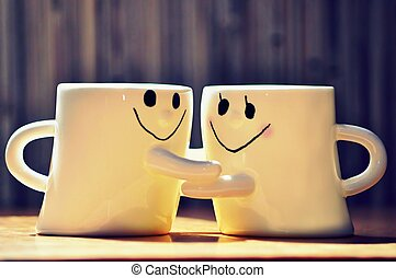 Cute Hugging Cups - Two cute cups hugging