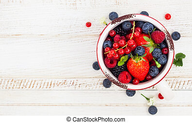 Fresh berries - Fresh summer berries in vintage mug over...