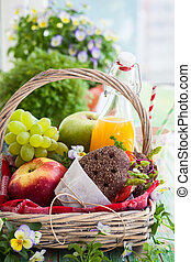 Picnic basket with fruits,juice and sandwiches
