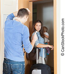 Angry woman leaving from home - Angry woman with child...