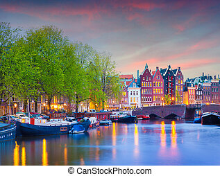 Colorful spring sunset on the canals of Amsterdam. Authentic...