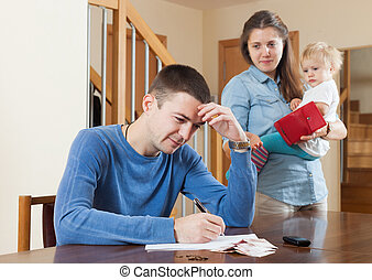 Financial problems in family - Depressed woman with baby...