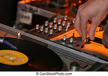 Disk and DJ - A detail of a gramophone disc with a DJ´s...