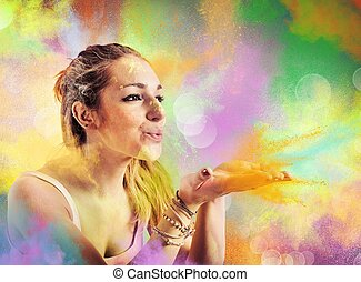 Girl blowing colored powders - Girl blowing dust colored...