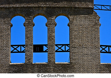 wall in plaza de toros - old window and wall in plaza de...