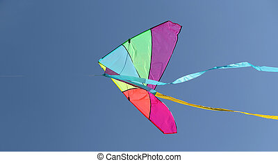kite flying high in the sky blue - colorful kite flying high...