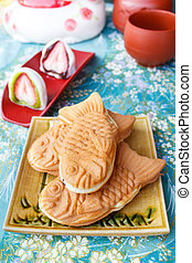 Japanese traditional fish-shaped cake, Taiyaki. - taiyaki of...