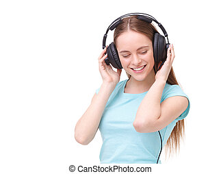 Young woman with headphones listening to music and dancing.
