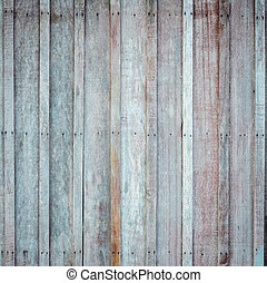 Wooden wall with the hammered rusty nails background - Rough...