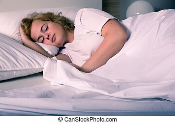 Sleeping young woman - A plus size young woman sleeping in...