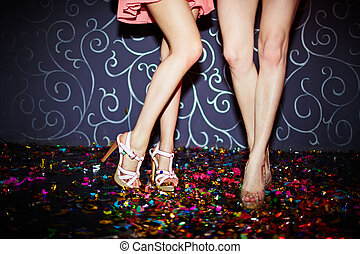 Legs of dancers - Legs of two girls dancing in night club